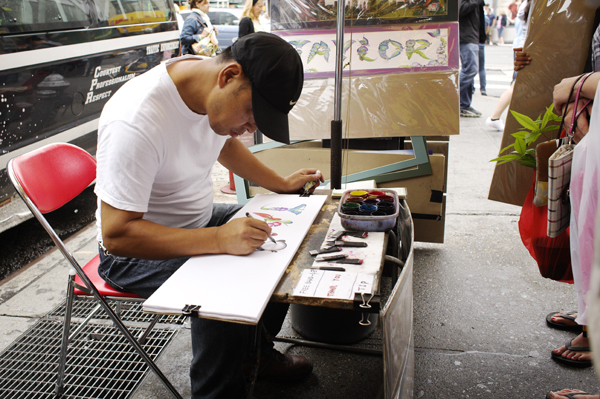 Street artist, Chinatown, NYC