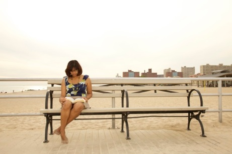 Woman on the beach at Coney Island, Brooklyn, USA